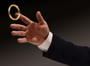 Business man's hand reaching for the brass ring